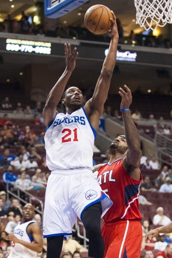 Apr 10, 2013; Philadelphia, PA, USA; Philadelphia 76ers forward Thaddeus Young (21) shoots during the first quarter against the Atlanta Hawks at the Wells Fargo Center. Mandatory Credit: Howard Smith-USA TODAY Sports