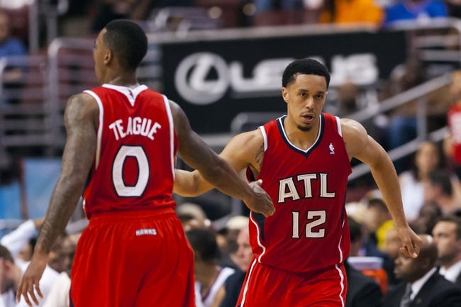 Apr 10, 2013; Philadelphia, PA, USA; Atlanta Hawks guard John Jenkins (12) celebrates with guard Jeff Teague (0) during the third quarter against the Philadelphia 76ers at the Wells Fargo Center. The Hawks defeated the Sixers 124-101. Mandatory Credit: Howard Smith-USA TODAY Sports