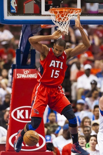 Apr 10, 2013; Philadelphia, PA, USA; Atlanta Hawks center Al Horford (15) dunks during the third quarter against the Philadelphia 76ers at the Wells Fargo Center. The Hawks defeated the Sixers 124-101. Mandatory Credit: Howard Smith-USA TODAY Sports