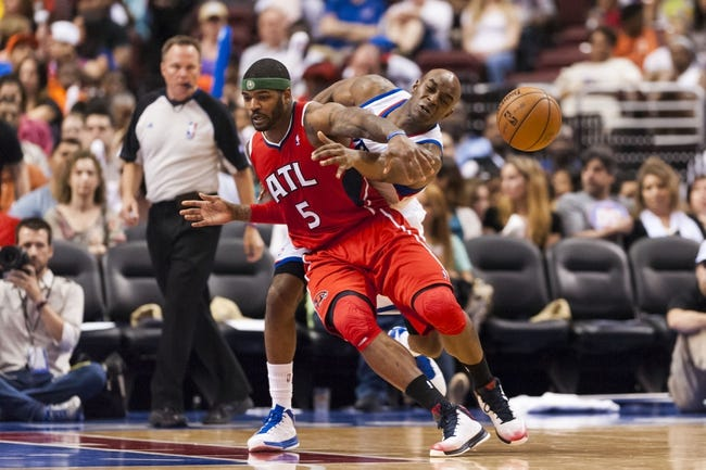 Apr 10, 2013; Philadelphia, PA, USA; Philadelphia 76ers guard Damien Wilkins (8) knocks the ball away from Atlanta Hawks forward Josh Smith (5) during the third quarter at the Wells Fargo Center. The Hawks defeated the Sixers 124-101. Mandatory Credit: Howard Smith-USA TODAY Sports