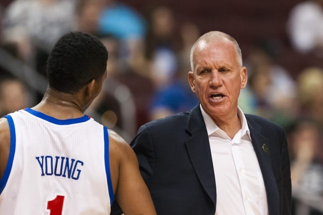 Apr 10, 2013; Philadelphia, PA, USA; Philadelphia 76ers head coach Doug Collins talks with guard Nick Young (1) during the fourth quarter against the Atlanta Hawks at the Wells Fargo Center. The Hawks defeated the Sixers 124-101. Mandatory Credit: Howard Smith-USA TODAY Sports