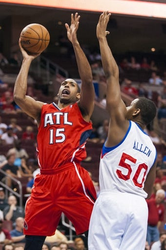 Apr 10, 2013; Philadelphia, PA, USA; Atlanta Hawks center Al Horford (15) shoots under pressure from Philadelphia 76ers center Lavoy Allen (50) during the fourth quarter at the Wells Fargo Center. The Hawks defeated the Sixers 124-101. Mandatory Credit: Howard Smith-USA TODAY Sports