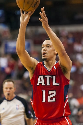 Apr 10, 2013; Philadelphia, PA, USA; Atlanta Hawks guard John Jenkins (12) passes the ball during the fourth quarter against the Philadelphia 76ers at the Wells Fargo Center. The Hawks defeated the Sixers 124-101. Mandatory Credit: Howard Smith-USA TODAY Sports