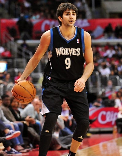 April 10, 2013; Los Angeles, CA, USA; Minnesota Timberwolves point guard Ricky Rubio (9) controls the ball against the Los Angeles Clippers during the first half at Staples Center. Mandatory Credit: Gary A. Vasquez-USA TODAY Sports
