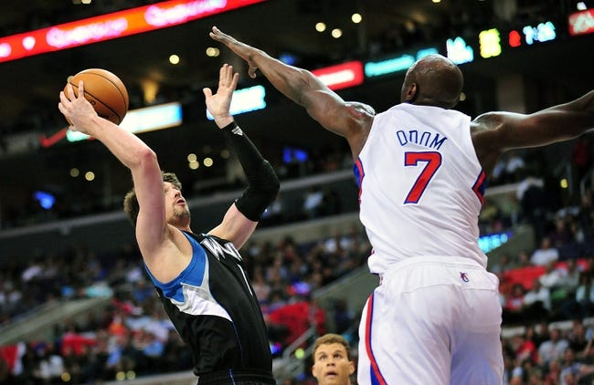 April 10, 2013; Los Angeles, CA, USA; Minnesota Timberwolves point guard Alexey Shved (1) is defended by Los Angeles Clippers power forward Lamar Odom (7) during the first half at Staples Center. Mandatory Credit: Gary A. Vasquez-USA TODAY Sports