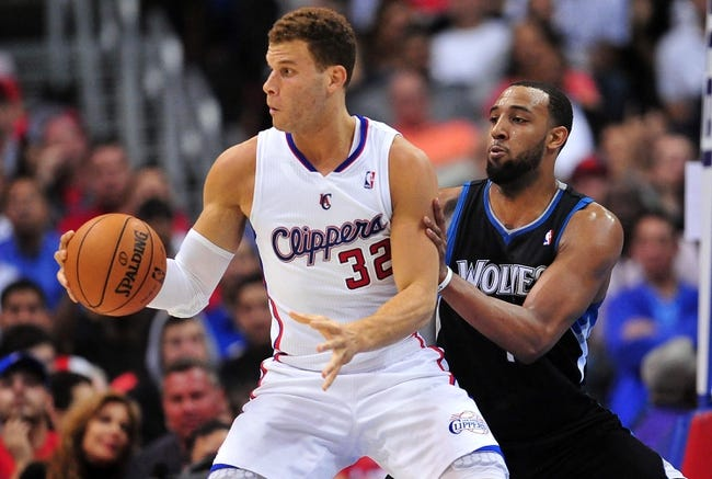 April 10, 2013; Los Angeles, CA, USA; Los Angeles Clippers power forward Blake Griffin (32) controls the ball against the defense of Minnesota Timberwolves power forward Derrick Williams (7) during the first half at Staples Center. Mandatory Credit: Gary A. Vasquez-USA TODAY Sports