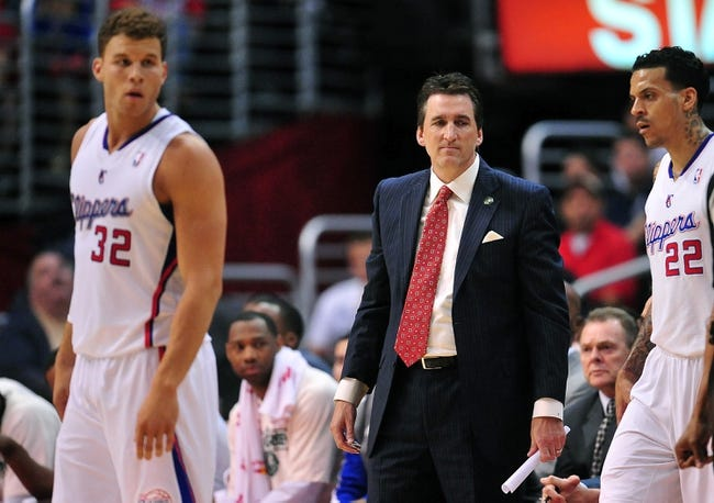 April 10, 2013; Los Angeles, CA, USA; Los Angeles Clippers head coach Vinny Del Negro with power forward Blake Griffin (32) and small forward Matt Barnes (22) during a stoppage in play against the Minnesota Timberwolves during the first half at Staples Center. Mandatory Credit: Gary A. Vasquez-USA TODAY Sports