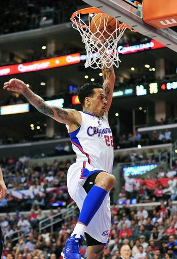 April 10, 2013; Los Angeles, CA, USA; Los Angeles Clippers small forward Matt Barnes (22) dunks to score a basket against the Minnesota Timberwolves during the second half at Staples Center. Mandatory Credit: Gary A. Vasquez-USA TODAY Sports