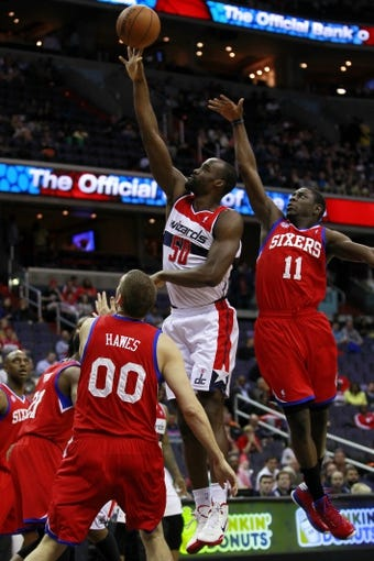 Apr 12, 2013; Washington, DC, USA; Washington Wizards center Emeka Okafor (50) shoots the ball as Philadelphia 76ers center Spencer Hawes (00) defends in the first quarter at Verizon Center. Mandatory Credit: Geoff Burke-USA TODAY Sports