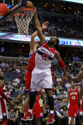 Apr 12, 2013; Washington, DC, USA; Washington Wizards center Nene (42) attempts to dunk the ball against Philadelphia 76ers center Spencer Hawes (00) in the first quarter at Verizon Center. Mandatory Credit: Geoff Burke-USA TODAY Sports