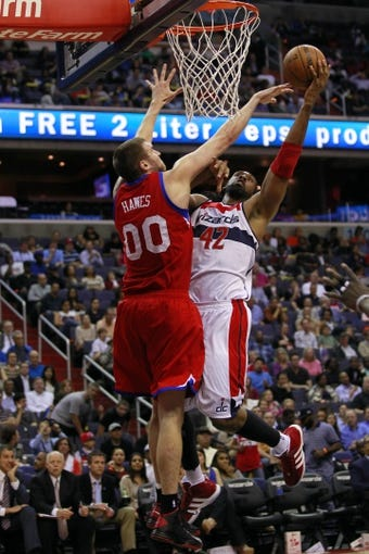 Apr 12, 2013; Washington, DC, USA; Washington Wizards center Nene (42) shoots the ball as Philadelphia 76ers center Spencer Hawes (00) defends in the second quarter at Verizon Center. Mandatory Credit: Geoff Burke-USA TODAY Sports