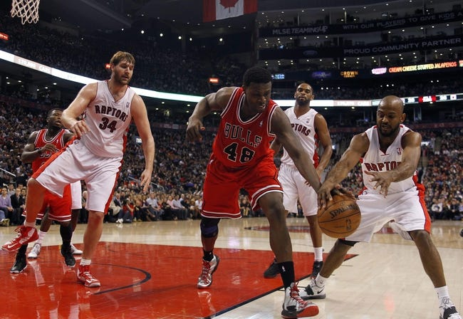 Apr 12, 2013; Toronto, Ontario, CAN; Chicago Bulls center Nazr Mohammed (48) and Toronto Raptors guard John Lucas III (5) try to keep the ball in bounds as center Aaron Gray (34) and forward-guard Alan Anderson (6) watch during the first half at the Air Canada Centre. Mandatory Credit: John E. Sokolowski-USA TODAY Sports