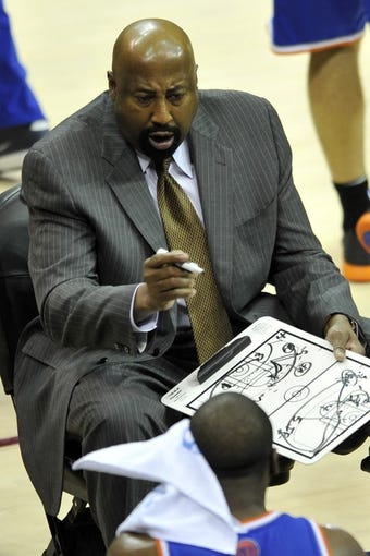 Apr 12, 2013; Cleveland, OH, USA; New York Knicks head coach Mike Woodson talks during a timeout in the first quarter against the Cleveland Cavaliers at Quicken Loans Arena. Mandatory Credit: David Richard-USA TODAY Sports