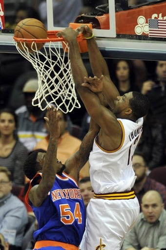 Apr 12, 2013; Cleveland, OH, USA; Cleveland Cavaliers power forward Tristan Thompson (13) dunks against New York Knicks forward Solomon Jones in the first quarter at Quicken Loans Arena. Mandatory Credit: David Richard-USA TODAY Sports