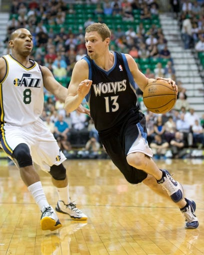 Apr 12, 2013; Salt Lake City, UT, USA; Minnesota Timberwolves point guard Luke Ridnour (13) dribbles around Utah Jazz point guard Randy Foye (8) during the first quarter at EnergySolutions Arena. Mandatory Credit: Russ Isabella-USA TODAY Sports