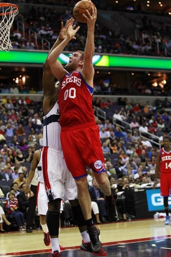 Apr 12, 2013; Washington, DC, USA; Philadelphia 76ers center Spencer Hawes (00) shoots the ball over Washington Wizards power forward Kevin Seraphin (13) in the fourth quarter at Verizon Center. The 76ers won 97-86. Mandatory Credit: Geoff Burke-USA TODAY Sports