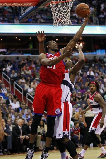 Apr 12, 2013; Washington, DC, USA; Philadelphia 76ers small forward Thaddeus Young (21) shoots the ball over Washington Wizards power forward Kevin Seraphin (13) in the fourth quarter at Verizon Center. The 76ers won 97-86. Mandatory Credit: Geoff Burke-USA TODAY Sports