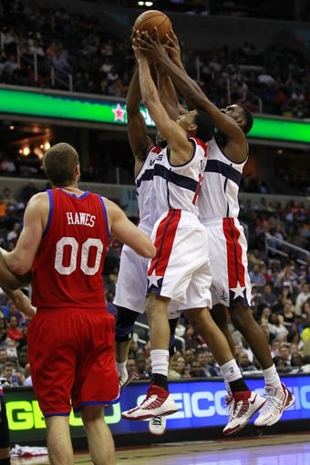 Apr 12, 2013; Washington, DC, USA; Washington Wizards center Emeka Okafor (50), Wizards shooting guard Garrett Temple (17), and Wizards small forward Chris Singleton (31) battle for a rebound in front of Philadelphia 76ers center Spencer Hawes (00) in the fourth quarter at Verizon Center. The 76ers won 97-86. Mandatory Credit: Geoff Burke-USA TODAY Sports