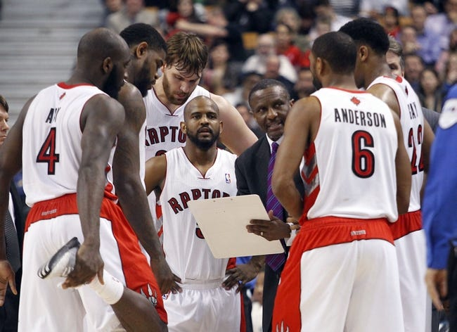 Apr 12, 2013; Toronto, Ontario, CAN; Toronto Raptors head coach Dwane Casey talks to his team during a break in the action against the Chicago Bulls during the second half at the Air Canada Centre. Toronto defeated Chicago 97-88. Mandatory Credit: John E. Sokolowski-USA TODAY Sports