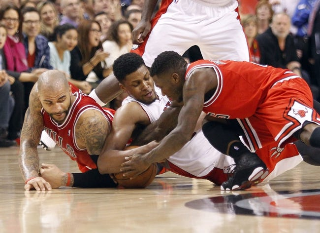 Apr 12, 2013; Toronto, Ontario, CAN; Toronto Raptors forward Rudy Gay (22) and Chicago Bulls forward Carlos Boozer (5) and Chicago Bulls guard Nate Robinson (2) battle for possession of the ball during the second half at the Air Canada Centre. Toronto defeated Chicago 97-88. Mandatory Credit: John E. Sokolowski-USA TODAY Sports