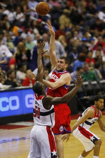 Apr 12, 2013; Washington, DC, USA; Philadelphia 76ers center Spencer Hawes (00) shoots the ball over Washington Wizards center Emeka Okafor (50) in the third quarter at Verizon Center. The 76ers won 97-86. Mandatory Credit: Geoff Burke-USA TODAY Sports