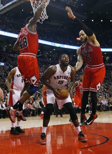 Apr 12, 2013; Toronto, Ontario, CAN; Chicago Bulls center Nazr Mohammed (48) and forward Carlos Boozer (5) defend against Toronto Raptors center-forward Amir Johnson (15) at the Air Canada Centre. Toronto defeated Chicago 97-88. Mandatory Credit: John E. Sokolowski-USA TODAY Sports