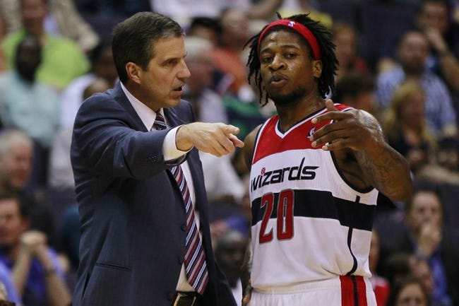 Apr 12, 2013; Washington, DC, USA; A Washington Wizards head coach Randy Wittman (l) talks to Wizards power forward Cartier Martin (20) in the third quarter against the Philadelphia 76ers at Verizon Center. The 76ers won 97-86. Mandatory Credit: Geoff Burke-USA TODAY Sports
