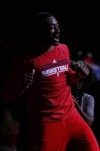 Apr 12, 2013; Washington, DC, USA; Washington Wizards point guard John Wall (2) is introduced prior to the Wizards' game against the Philadelphia 76ers at Verizon Center. The 76ers won 97-86. Mandatory Credit: Geoff Burke-USA TODAY Sports