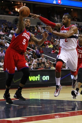 Apr 12, 2013; Washington, DC, USA; Washington Wizards point guard John Wall (2) passes the ball in front of Philadelphia 76ers power forward Arnett Moultrie (5) in the first quarter at Verizon Center. The 76ers won 97-86. Mandatory Credit: Geoff Burke-USA TODAY Sports