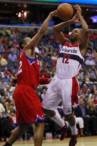 Apr 12, 2013; Washington, DC, USA; Philadelphia 76ers small forward Evan Turner (12) knocks the ball from Washington Wizards point guard A.J. Price (12) in the second quarter at Verizon Center. The 76ers won 97-86. Mandatory Credit: Geoff Burke-USA TODAY Sports