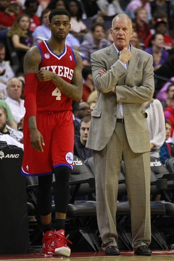 Apr 12, 2013; Washington, DC, USA; Philadelphia 76ers small forward Dorell Wright (4) talks with 76ers head coach Doug Collins (r) against the Washington Wizards in the third quarter at Verizon Center. The 76ers won 97-86. Mandatory Credit: Geoff Burke-USA TODAY Sports