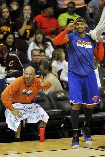 Apr 12, 2013; Cleveland, OH, USA; New York Knicks small forward Carmelo Anthony (right) and point guard Jason Kidd celebrate in the fourth quarter against the Cleveland Cavaliers at Quicken Loans Arena. Mandatory Credit: David Richard-USA TODAY Sports