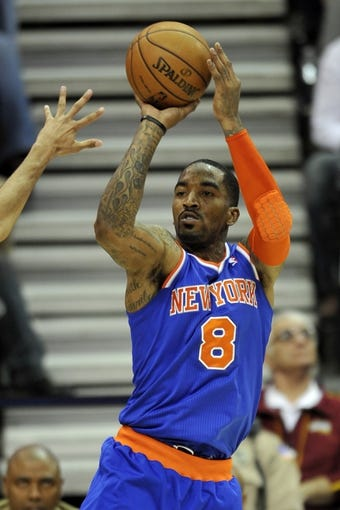 Apr 12, 2013; Cleveland, OH, USA; New York Knicks shooting guard J.R. Smith (8) shoots against the Cleveland Cavaliers in the fourth quarter at Quicken Loans Arena. Mandatory Credit: David Richard-USA TODAY Sports