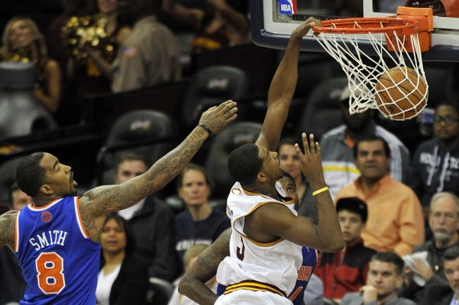 Apr 12, 2013; Cleveland, OH, USA; Cleveland Cavaliers power forward Tristan Thompson (13) dunks beside New York Knicks shooting guard J.R. Smith (8) in the first quarter at Quicken Loans Arena. Mandatory Credit: David Richard-USA TODAY Sports