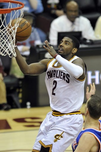 Apr 12, 2013; Cleveland, OH, USA; Cleveland Cavaliers point guard Kyrie Irving (2) drives to the basket in the second quarter against the New York Knicks at Quicken Loans Arena. Mandatory Credit: David Richard-USA TODAY Sports