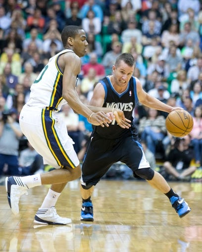 Apr 12, 2013; Salt Lake City, UT, USA; Minnesota Timberwolves point guard J.J. Barea (11) attempts to dribble around Utah Jazz point guard Alec Burks (10) during the first half at EnergySolutions Arena. Mandatory Credit: Russ Isabella-USA TODAY Sports