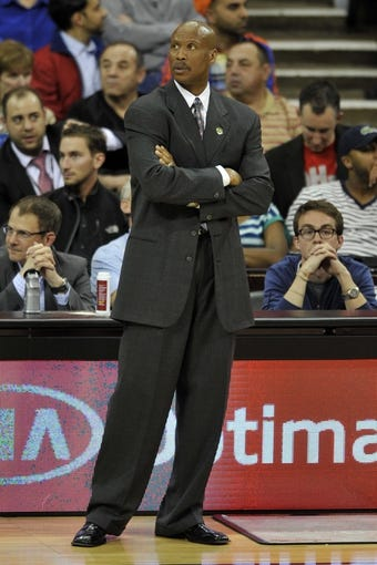 Apr 12, 2013; Cleveland, OH, USA; Cleveland Cavaliers head coach Byron Scott glances at the score board in the fourth quarter against the New York Knicks at Quicken Loans Arena. Mandatory Credit: David Richard-USA TODAY Sports