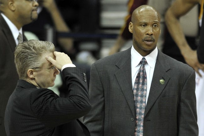 Apr 12, 2013; Cleveland, OH, USA; Cleveland Cavaliers assistant coach Joe Prunty (left) and head coach Byron Scott stand on the court during a timeout in the fourth quarter against the New York Knicks at Quicken Loans Arena. Mandatory Credit: David Richard-USA TODAY Sports