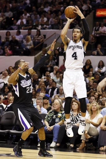 Apr 12, 2013; San Antonio, TX, USA; San Antonio Spurs guard Danny Green (4) shoots against Sacramento Kings guard Marcus Thornton (23) during the first half at the AT&T Center. Mandatory Credit: Soobum Im-USA TODAY Sports