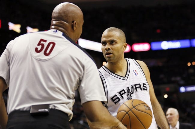 Apr 12, 2013; San Antonio, TX, USA; San Antonio Spurs guard Tony Parker (9) argues a call to NBA official Olandis Poole during the first half against the Sacramento Kings at the AT&T Center. Mandatory Credit: Soobum Im-USA TODAY Sports