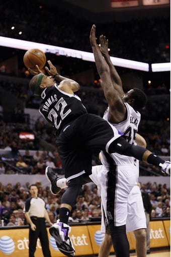 Apr 12, 2013; San Antonio, TX, USA; Sacramento Kings guard Isaiah Thomas (22) shoots as San Antonio Spurs forward DeJuan Blair (45) defends during the second half at the AT&T Center. Mandatory Credit: Soobum Im-USA TODAY Sports