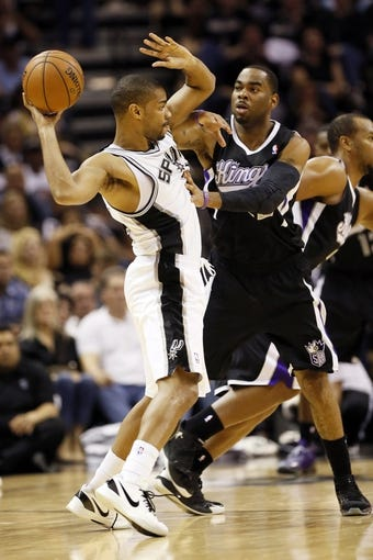Apr 12, 2013; San Antonio, TX, USA; San Antonio Spurs guard Gary Neal (left) is defended by Sacramento Kings guard Marcus Thornton (right) during the second half at the AT&T Center. Mandatory Credit: Soobum Im-USA TODAY Sports