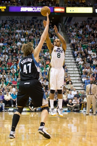 Apr 12, 2013; Salt Lake City, UT, USA; Utah Jazz point guard Randy Foye (8) shoots a three-point shot over Minnesota Timberwolves small forward Andrei Kirilenko (47) during the second half at EnergySolutions Arena. The Jazz won 107-100. Mandatory Credit: Russ Isabella-USA TODAY Sports