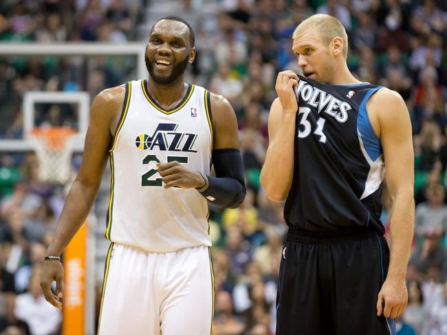 Apr 12, 2013; Salt Lake City, UT, USA; Utah Jazz center Al Jefferson (25) talks with Minnesota Timberwolves center Greg Stiemsma (34) during the second half at EnergySolutions Arena. The Jazz won 107-100. Mandatory Credit: Russ Isabella-USA TODAY Sports