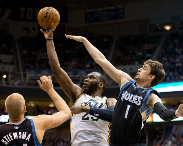 Apr 12, 2013; Salt Lake City, UT, USA; Utah Jazz center Al Jefferson (25) shoots while defended by Minnesota Timberwolves center Greg Stiemsma (34) and point guard Alexey Shved (1) during the second half at EnergySolutions Arena. The Jazz won 107-100. Mandatory Credit: Russ Isabella-USA TODAY Sports