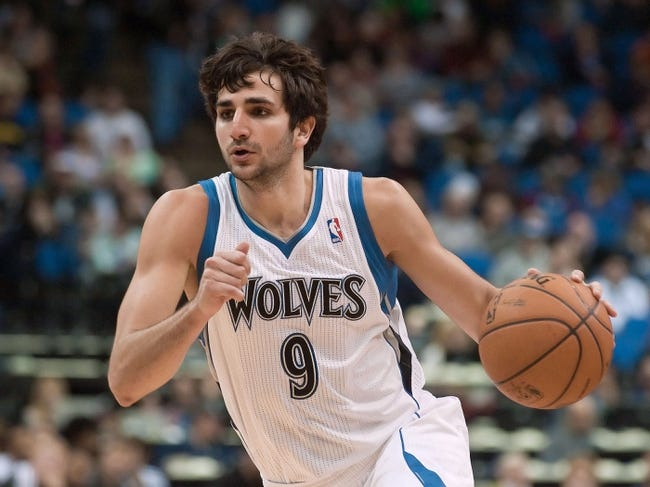 Apr 13, 2013; Minneapolis, MN, USA; Minnesota Timberwolves point guard Ricky Rubio (9) controls the ball against the Phoenix Suns in the fourth quarter at the Target Center. Timberwolves won 105-93. Mandatory Credit:  Greg Smith-USA TODAY Sports