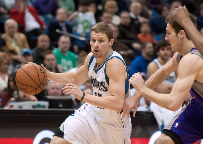 Apr 13, 2013; Minneapolis, MN, USA; Minnesota Timberwolves point guard Luke Ridnour (13) drives to the basket as he is defended by Phoenix Suns point guard Goran Dragic (1) in the fourth quarter at the Target Center. Timberwolves won 105-93. Mandatory Credit:  Greg Smith-USA TODAY Sports