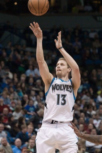 Apr 13, 2013; Minneapolis, MN, USA; Minnesota Timberwolves point guard Luke Ridnour (13) shoots against the Phoenix Suns during the fourth quarter at the Target Center. Timberwolves won 105-93. Mandatory Credit:  Greg Smith-USA TODAY Sports