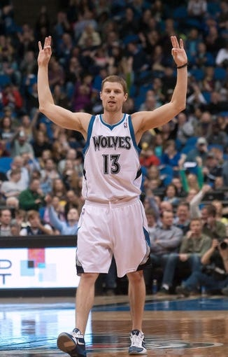 Apr 13, 2013; Minneapolis, MN, USA; Minnesota Timberwolves point guard Luke Ridnour (13) signals three points after a basket by Timberwolves point guard J.J. Barea (not pictured) during the fourth quarter against the Phoenix Suns at the Target Center. Timberwolves won 105-93. Mandatory Credit:  Greg Smith-USA TODAY Sports