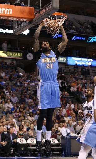 April 12, 2013; Dallas, TX, USA; Denver Nuggets forward Wilson Chandler (21) dunks against the Dallas Mavericks at the American Airlines Center. Mandatory Credit: Matthew Emmons-USA TODAY Sports